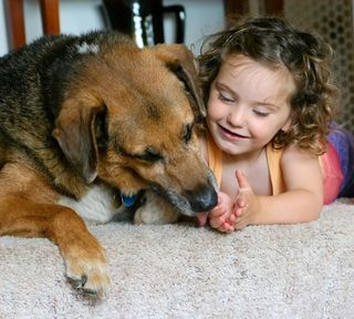 Bigstock-little-girl-with-her-dog-1052768